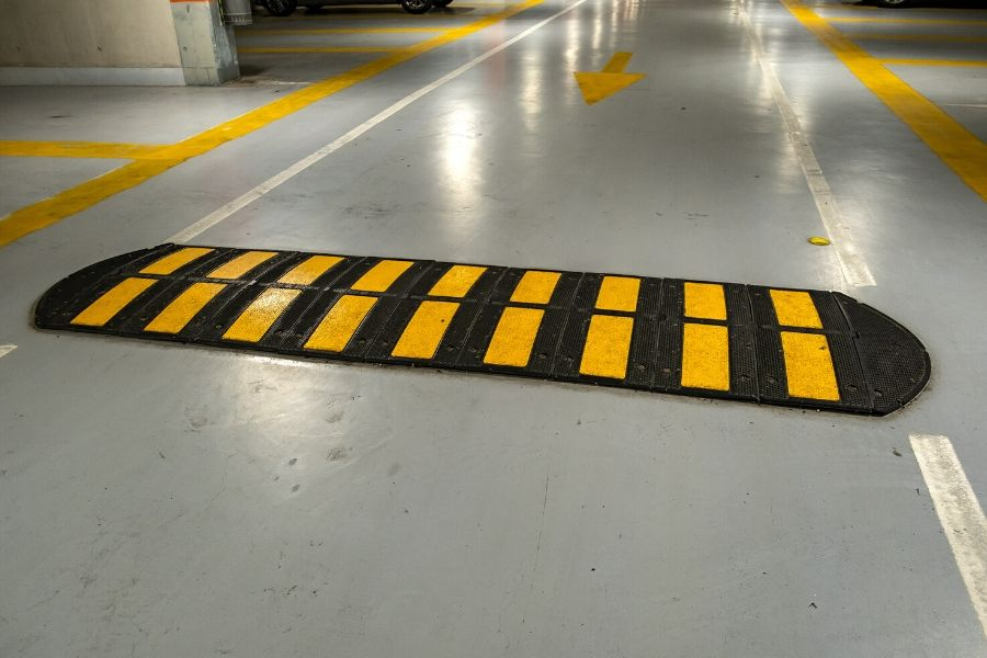 A speed bump installed in under parking lot in vanocuver