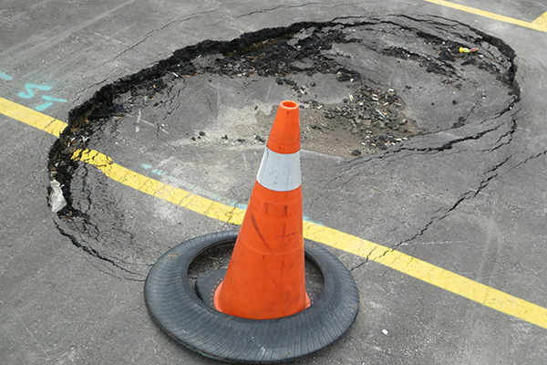 our commercial parking lot contractor can help you repair the hole on parking lots